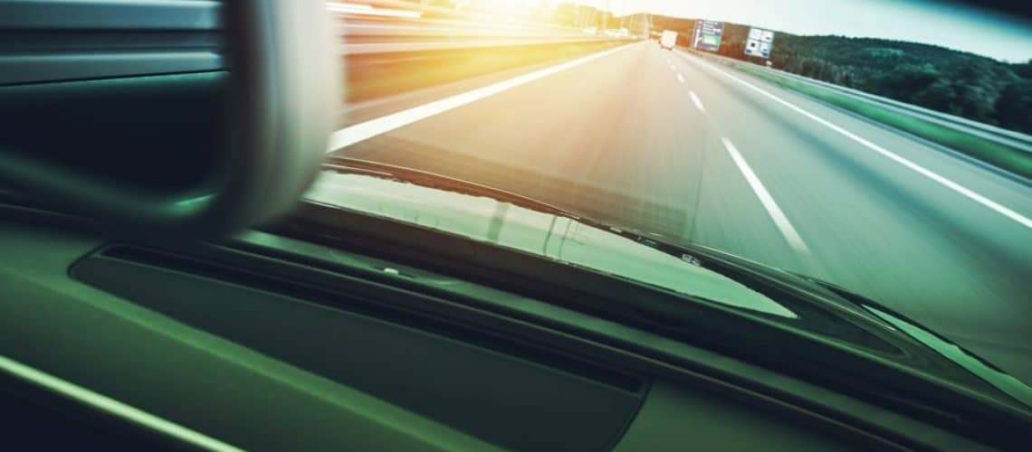 Highway Car Speeding with Motion Blurs. Car Driving Concept.